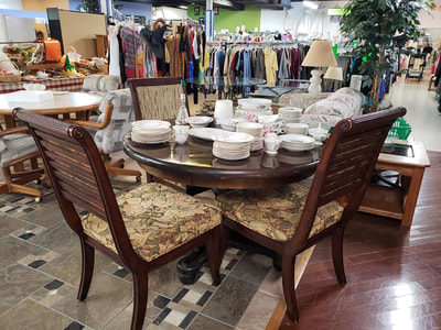 Resale Stores link. Image of furniture, clothing and dishes sold at one of the resale stores.