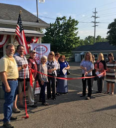 Ribbon cutting presented to Freedom Treasures Resale Store in Highland by the Highland White Lake Business Association.